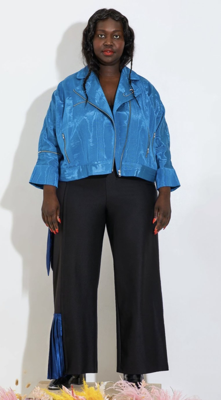 a model wearing hte pants with blue details