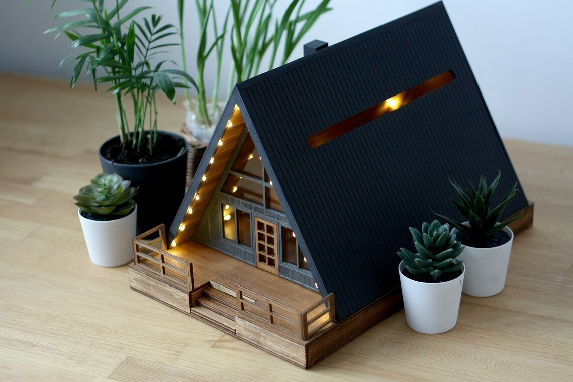 triangle shaped house that lights up