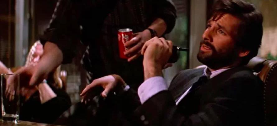 Someone bringing Ellis a coke