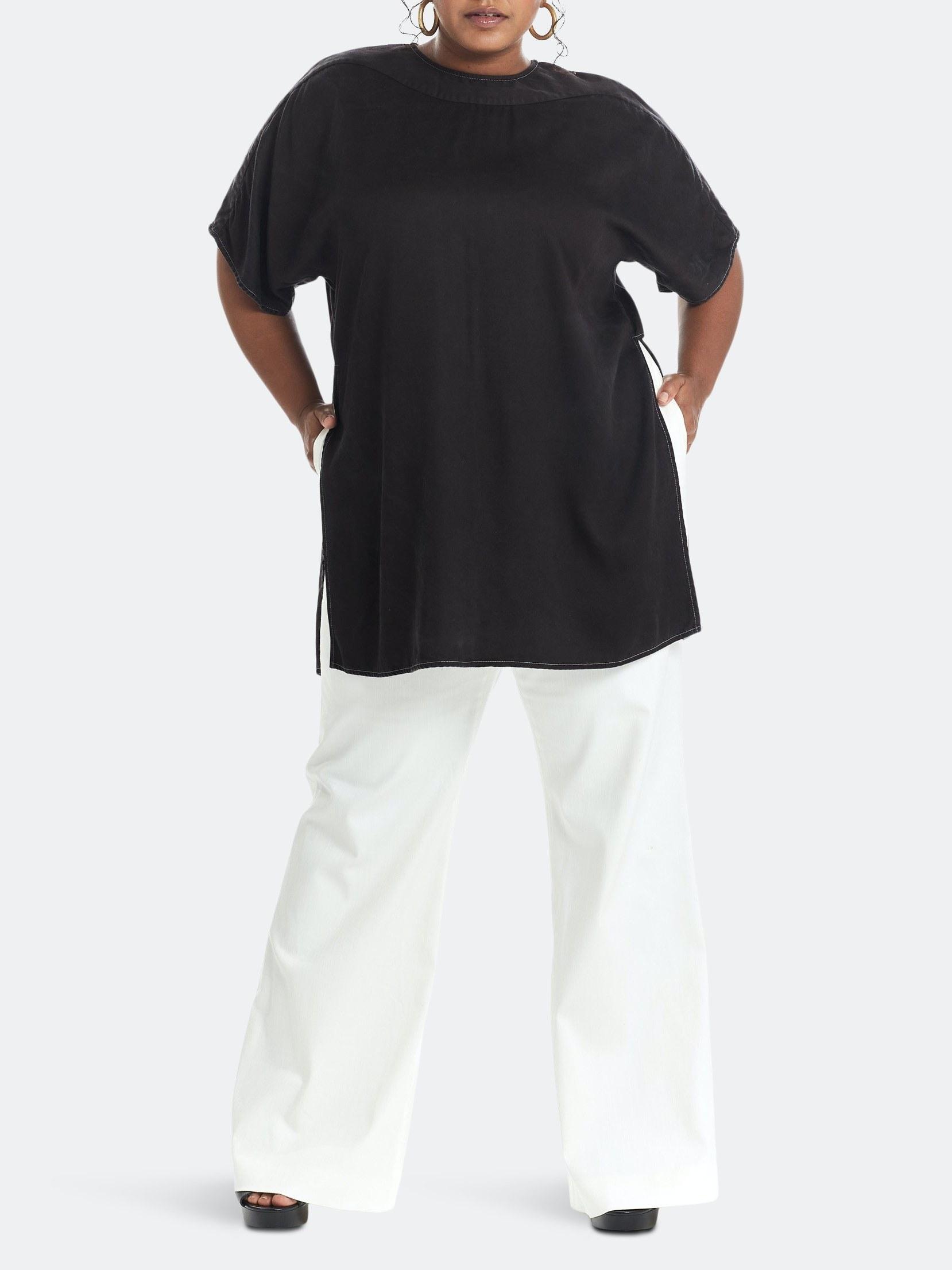 model wearing a black tunic