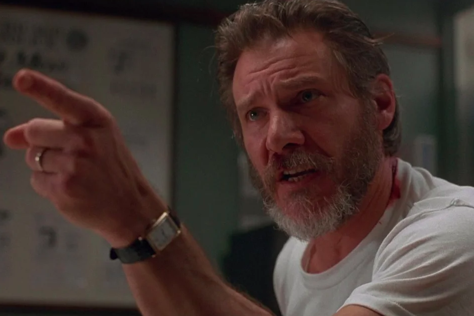 Harrison Ford pointing and looking concerned