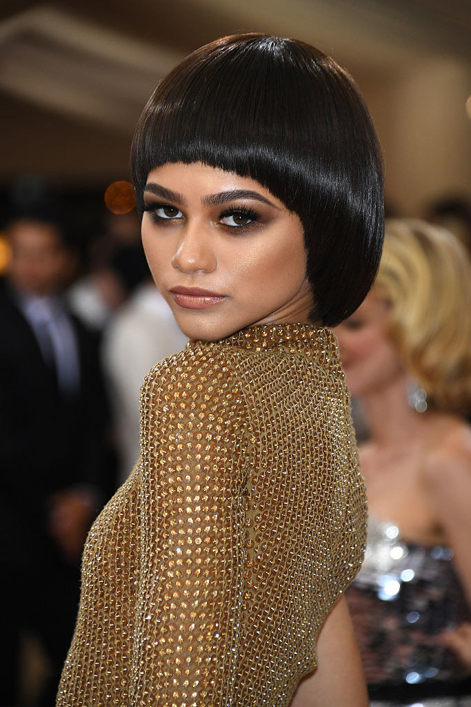 """Zendaya attends the """"Manus x Machina: Fashion In An Age Of Technology"""" Costume Institute Gala in a beaded gown with a 60's style bowl haircut"""
