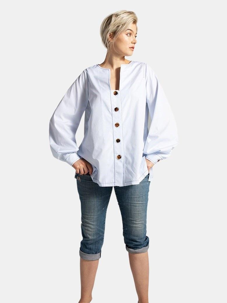 model wearing the shirt in blue