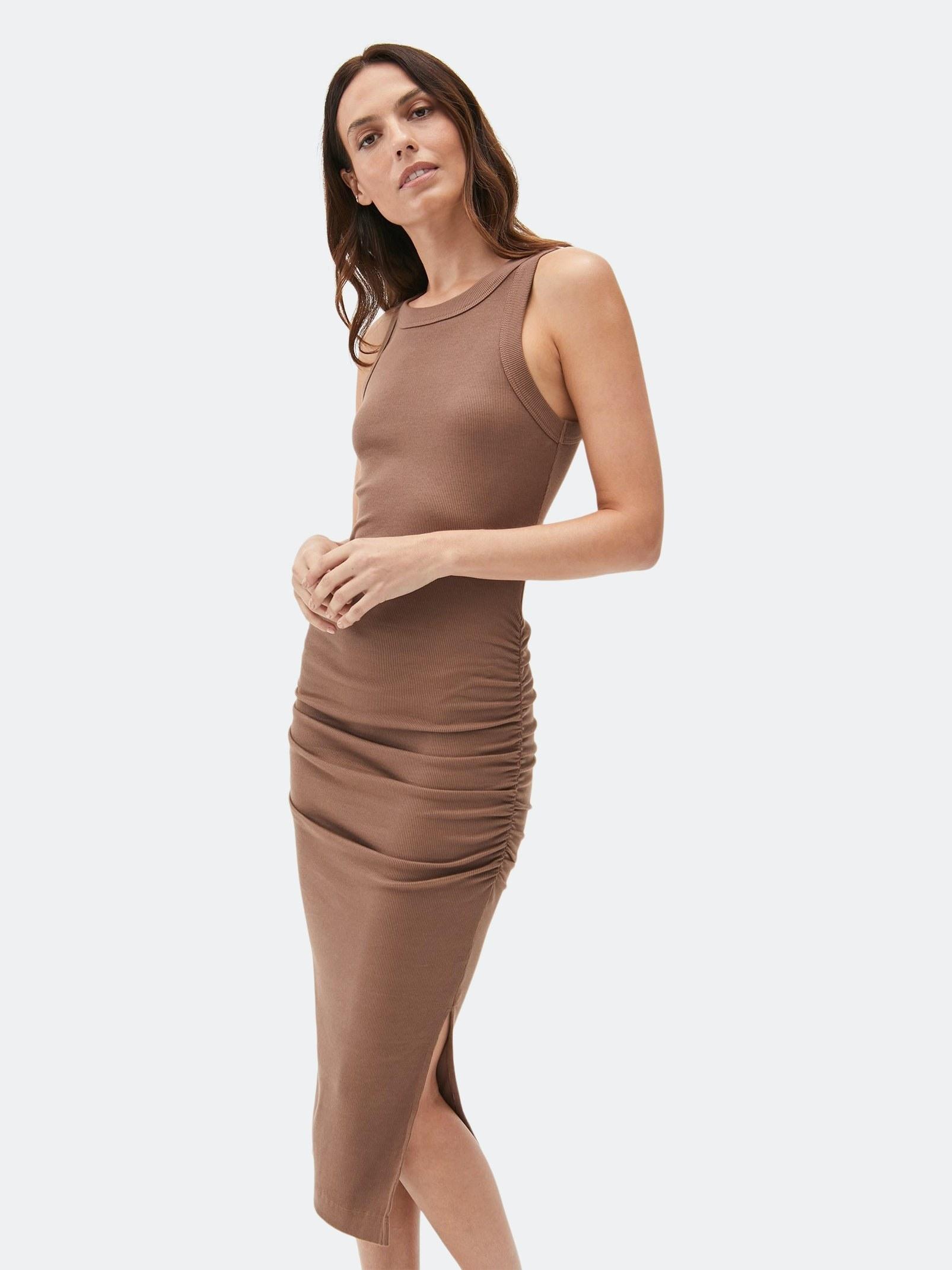 model wearing the dress in camel