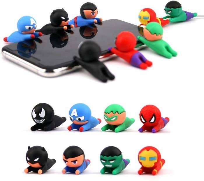 The cable protectors shaped like various superheros including iron man, spider man, captain america, batman, and hulk