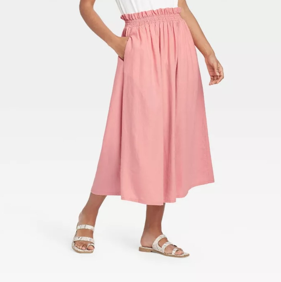 a model wearing the skirt in pink