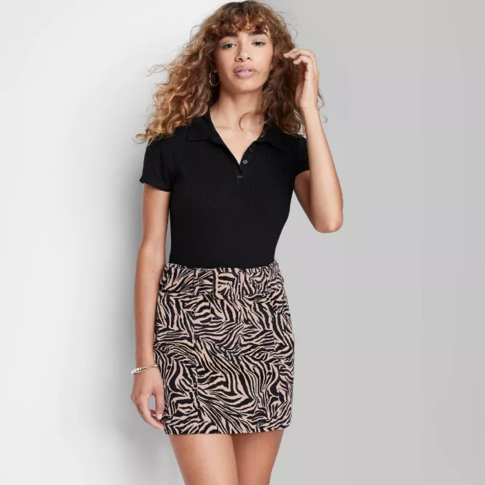 a model wearing the skirt in zebra stripe