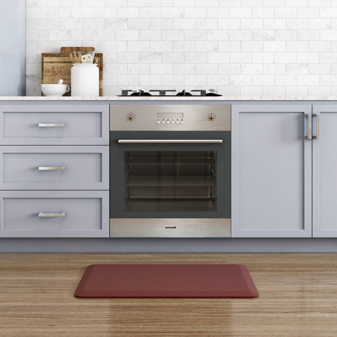 red anti fatigue mat in front of a stove
