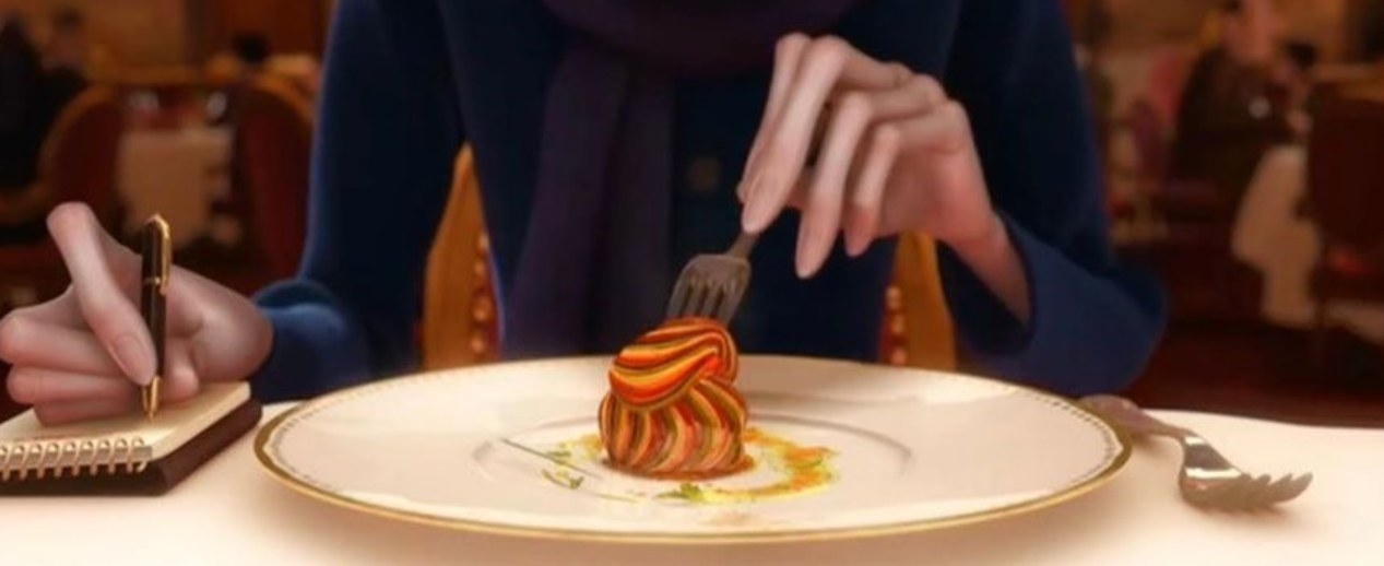 A close up of the ratatouille as someone sticks a fork in it