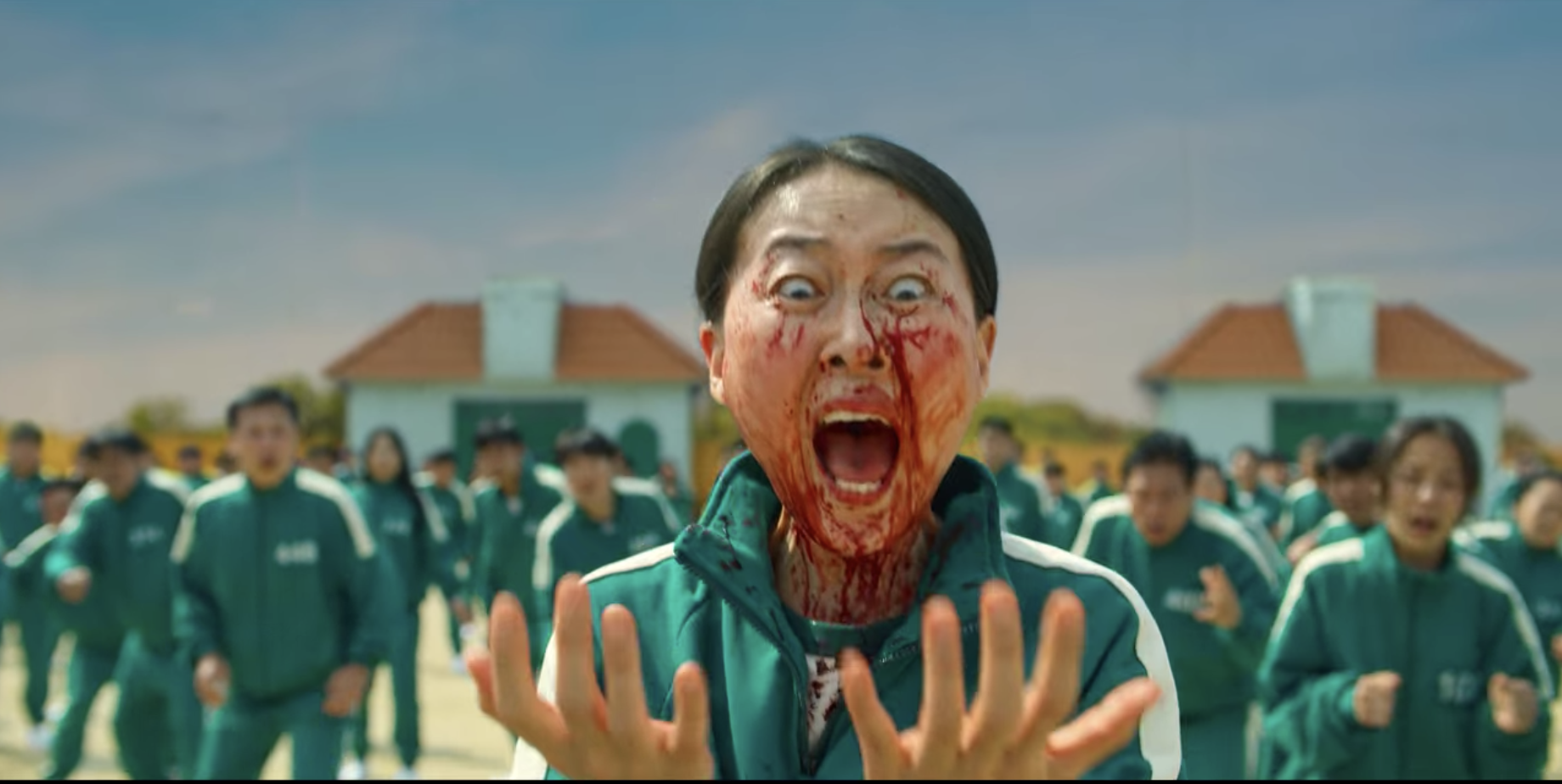 A woman screaming as she's covered in blood