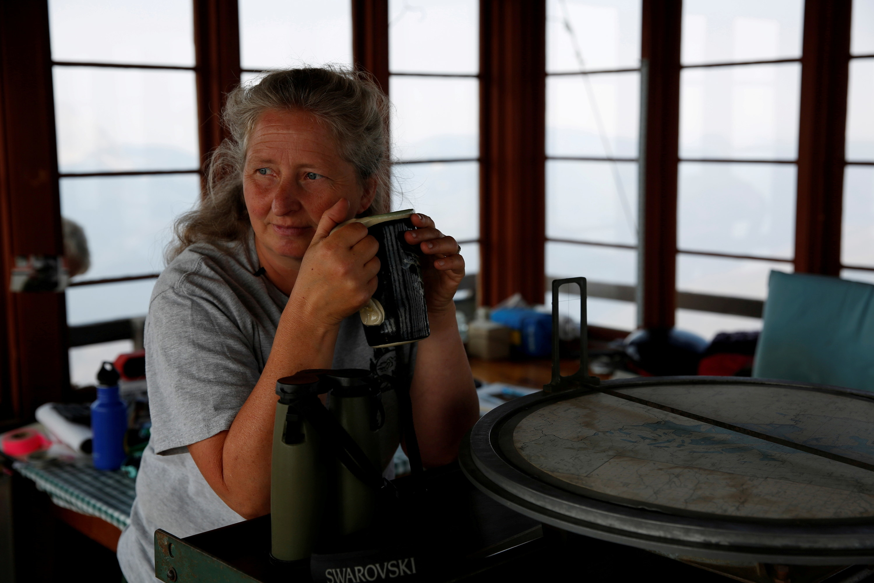 Samsara Duffey relaxes with a cup of coffee at the Patrol Mountain Fire lookout