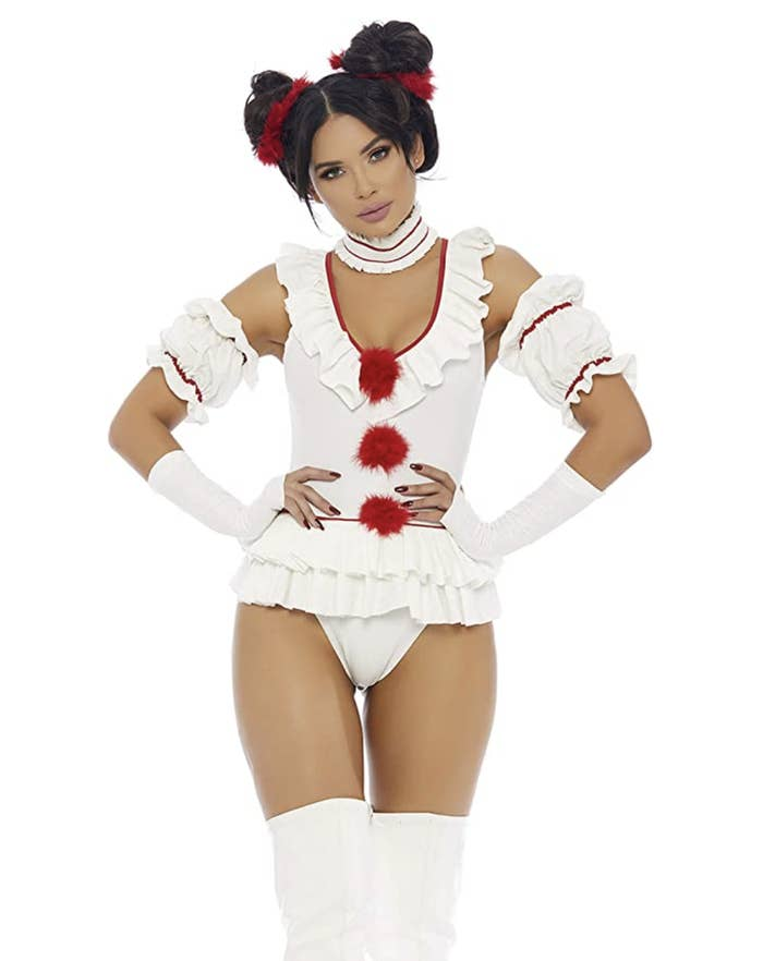 A white leotard with red pom poms down the center