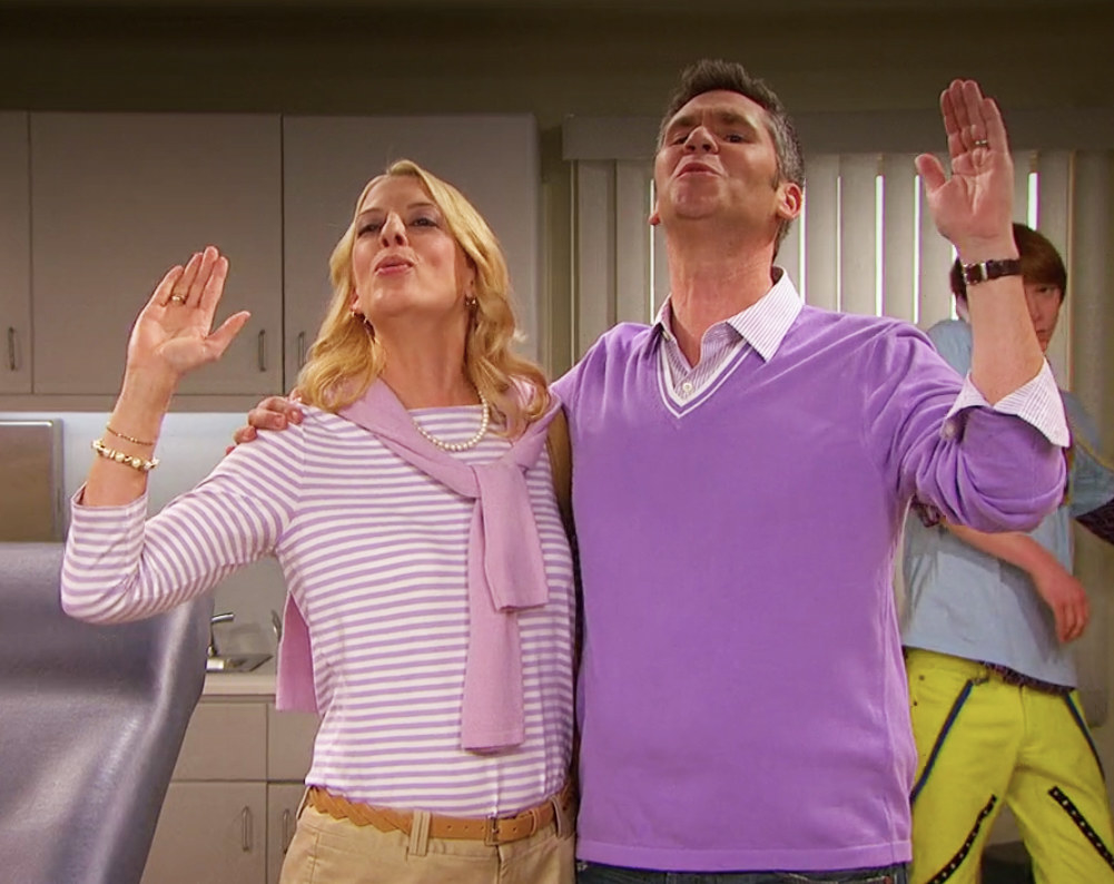 Mimi and Mike raising their hands and closing their eyes