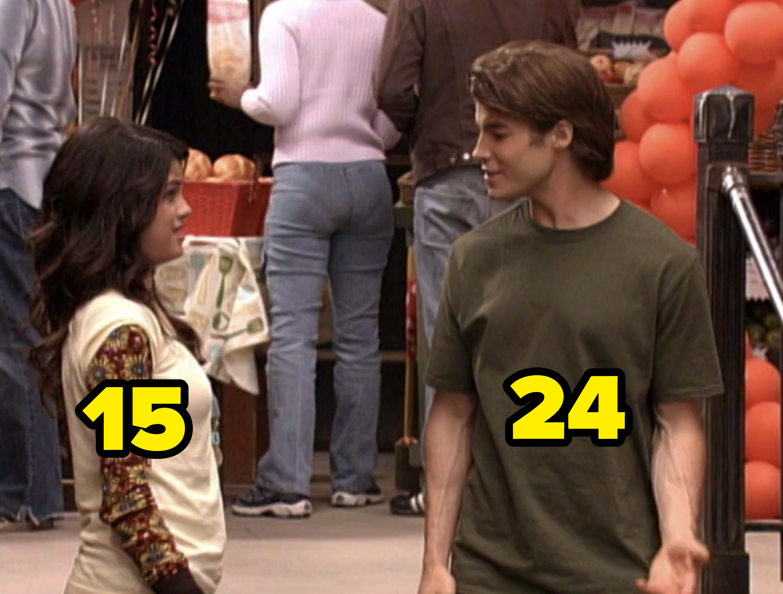 """Selena Gomez and Brian Kubach talking in a scene for """"Wizards of Waverly Place"""""""