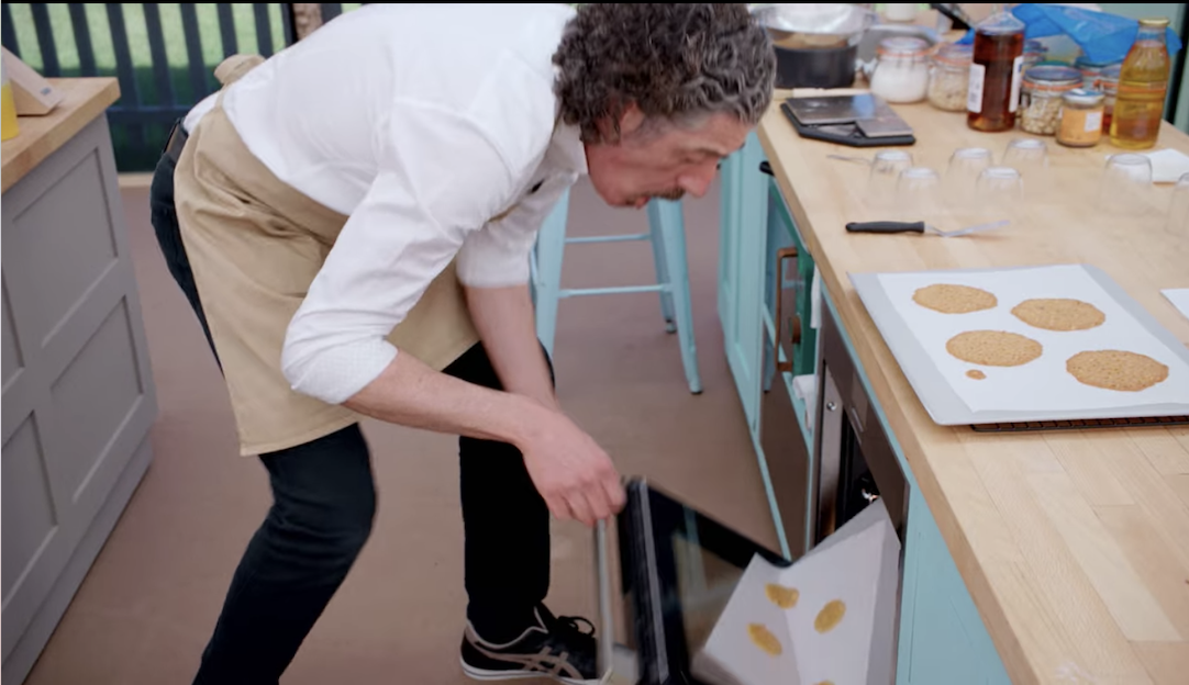 Giuseppe drops his biscuits on their way into the oven