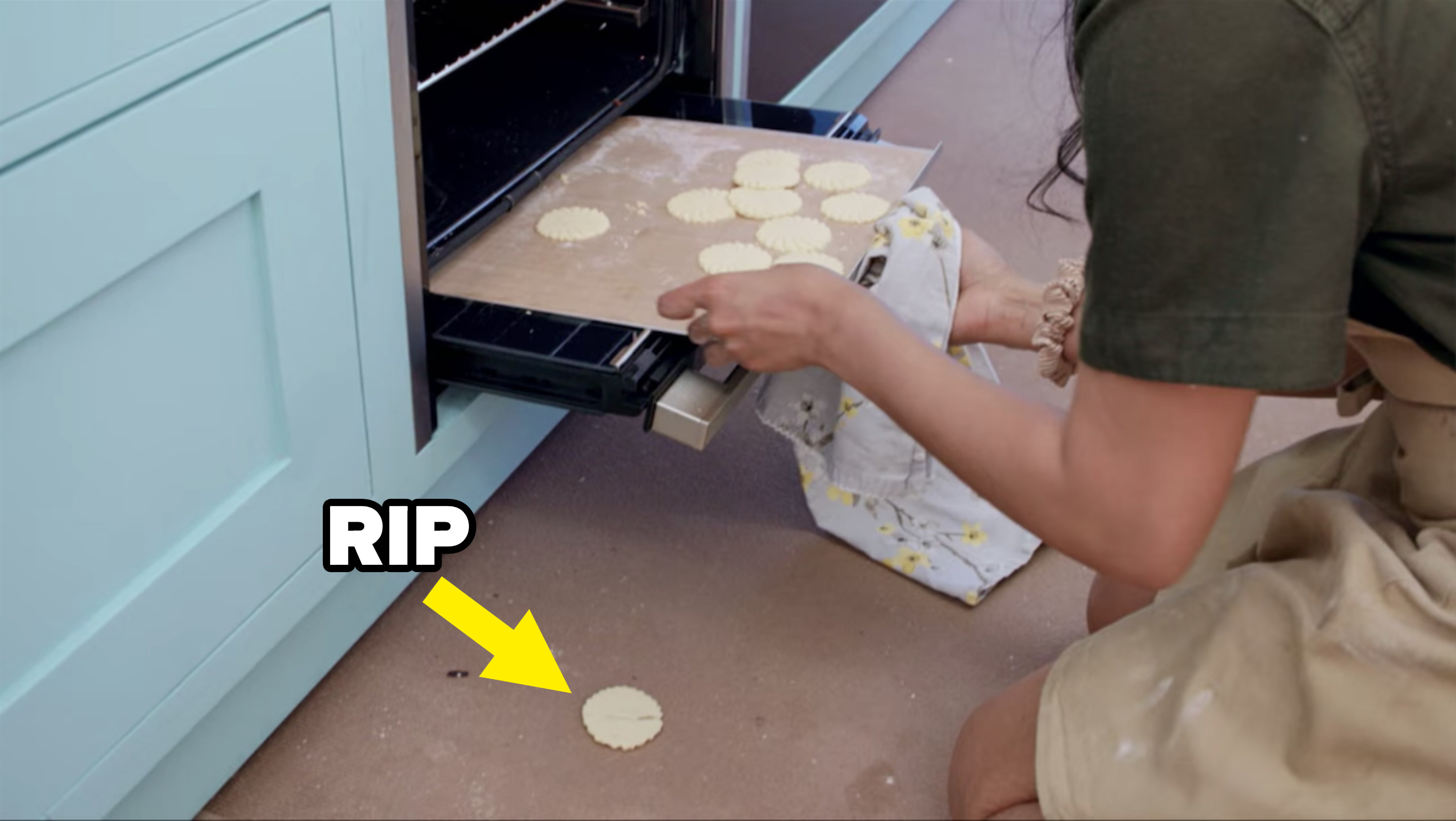 Crystelle drops her biscuits on their way into the oven
