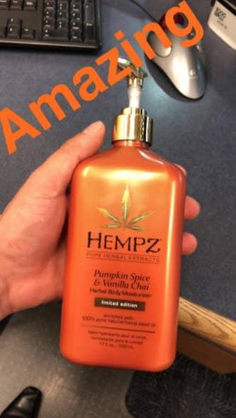 reviewer holding moisturizer