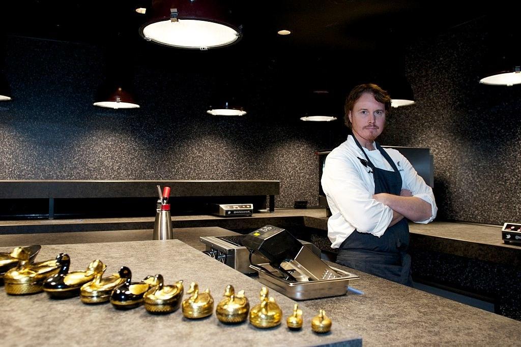 Achatz standing in a kitchen