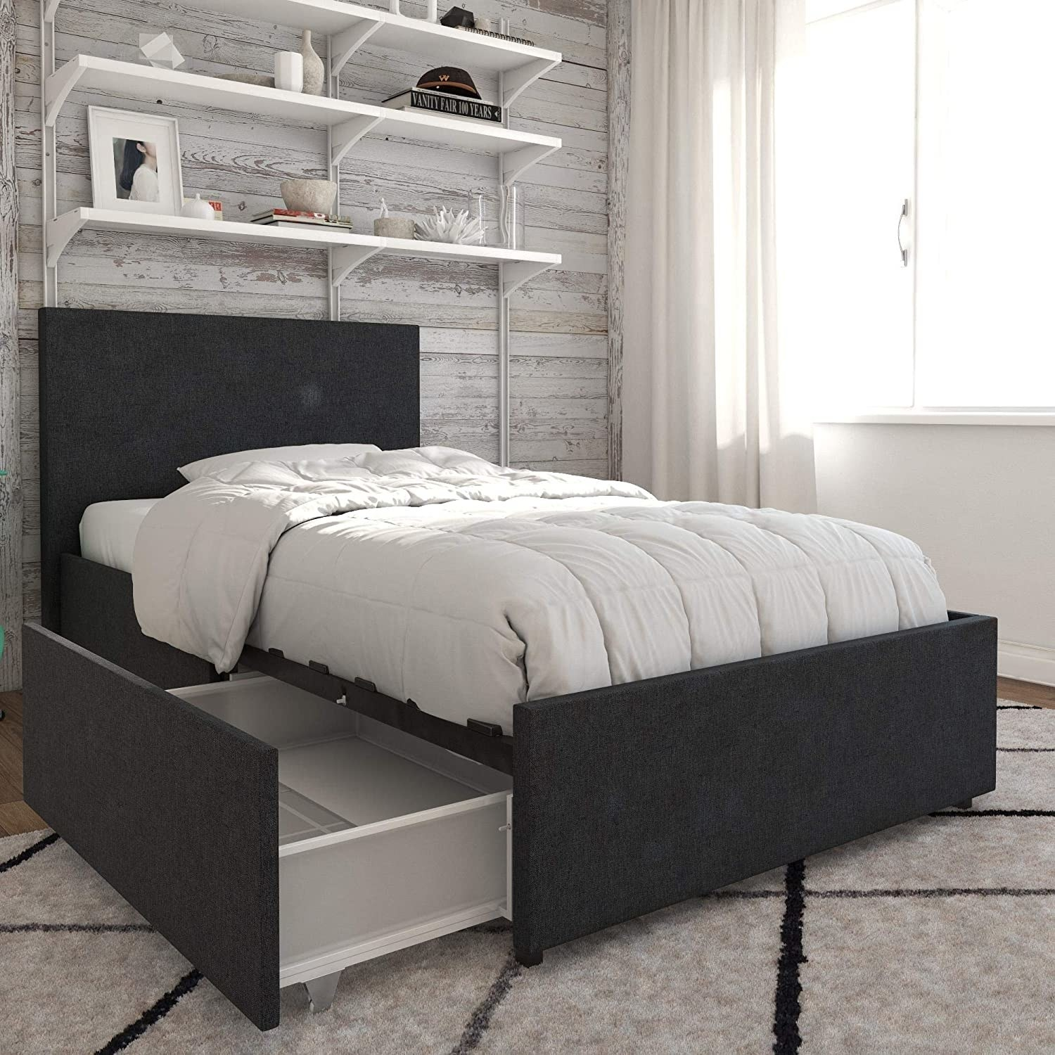 The bed with a drawer pulled out