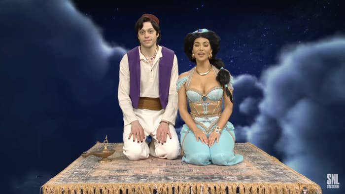 Jasmine and Aladdin sitting on the magical carpet