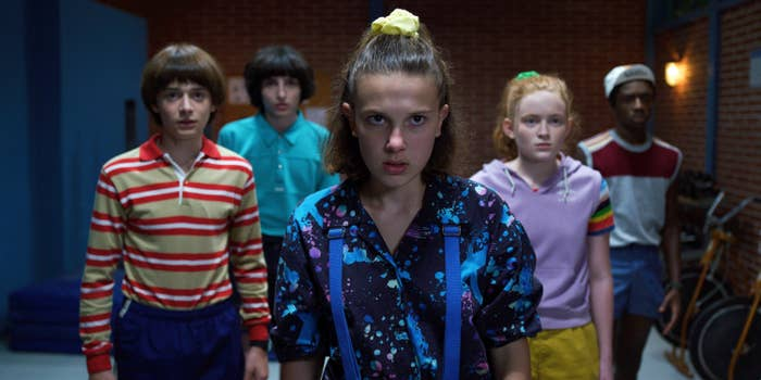 A scene from Stranger Things featuring the kids looking at something off-screen