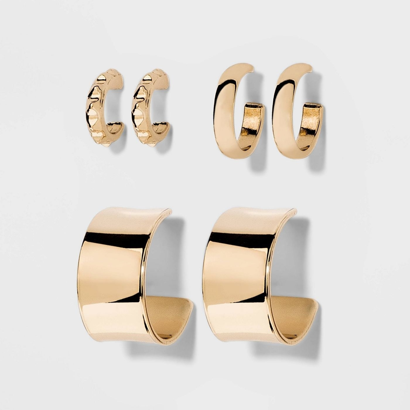 three sets of gold hoop earrings