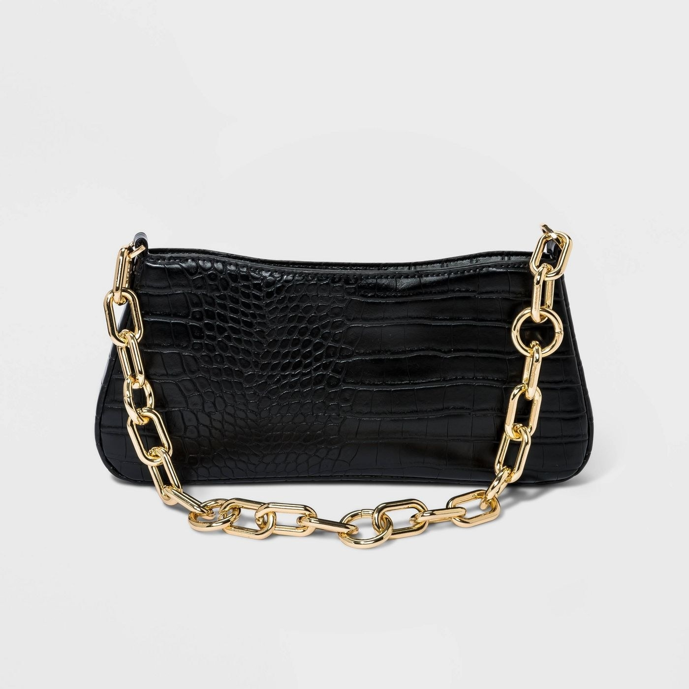 a faux alligator print purse with a chain for a handle