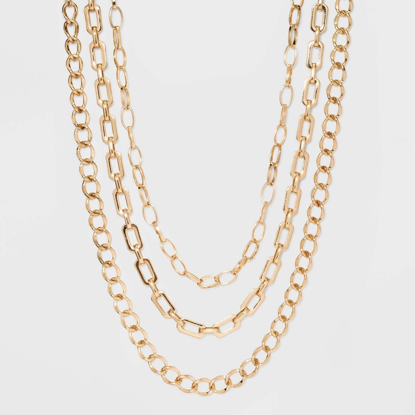 three chain link necklaces