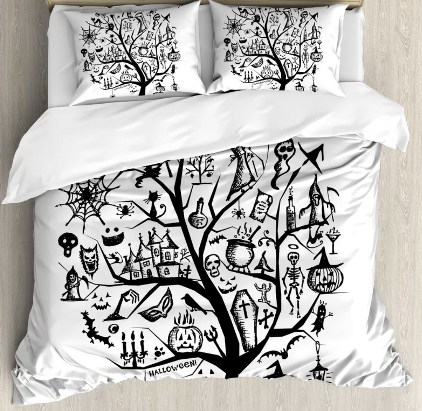 The white duvet and sham fabric has a large black tree that various Halloween elements like coffins, cauldrons, candles, masks and many other fun elements