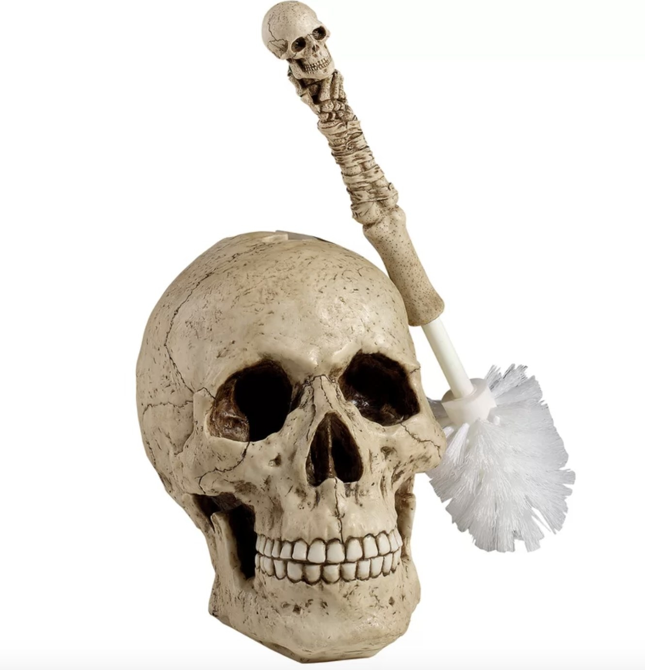 The large tan skull head has a femur shaped toilet brush with a small skull on top
