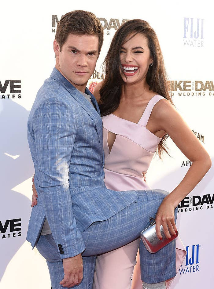 Adam and Chloe being playful on the red carpet
