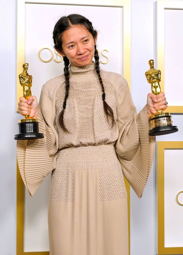 Chloé posing with her two Oscars