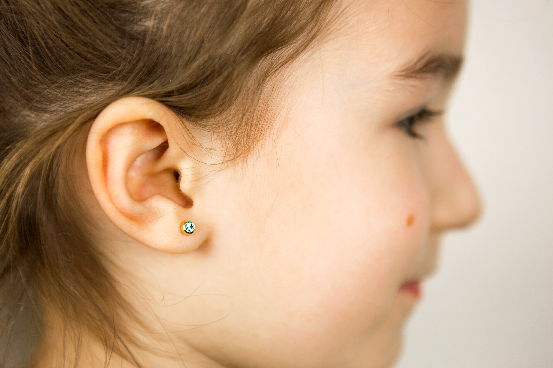 A little girl with an ear piercing