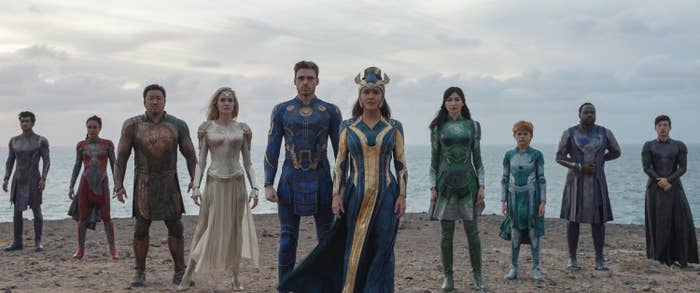 The members of the Eternals standing at. attention