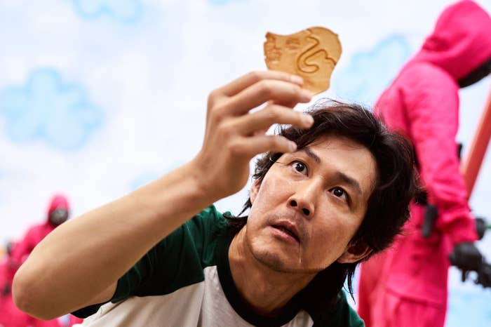 Gi-Hun holding the cookie in Squid Game