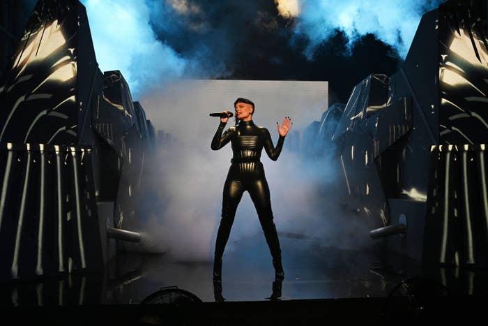 Halsey singing while wearing bodysuit