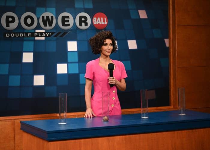 Kim Kardashian in a curly wig during a Powerball sketch
