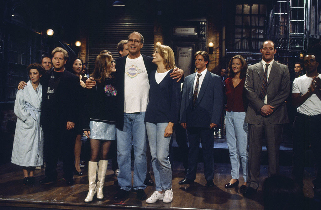 """Chevy Chase on stage with the cast of """"SNL"""""""
