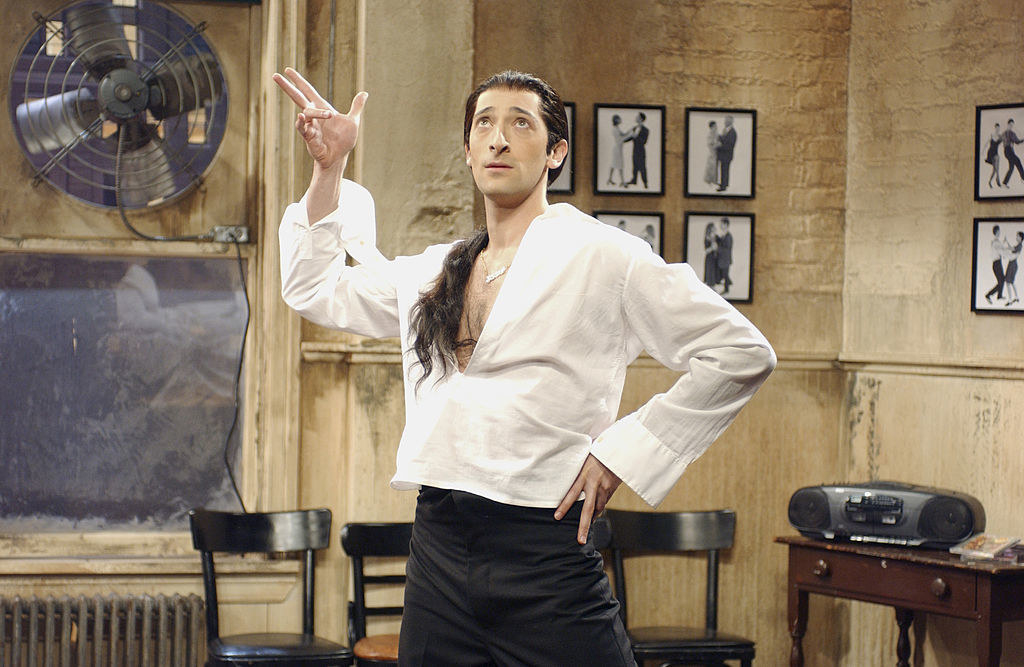 Adrian Brody wearing a light-colored shirt and long ponytail in a sketch