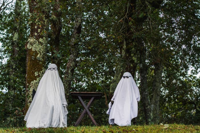 Ghosts wearing glasses while sitting at an outdoors table
