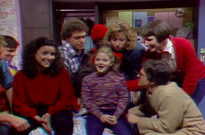"""7-year-old Drew Barrymore with the cast of """"SNL"""""""