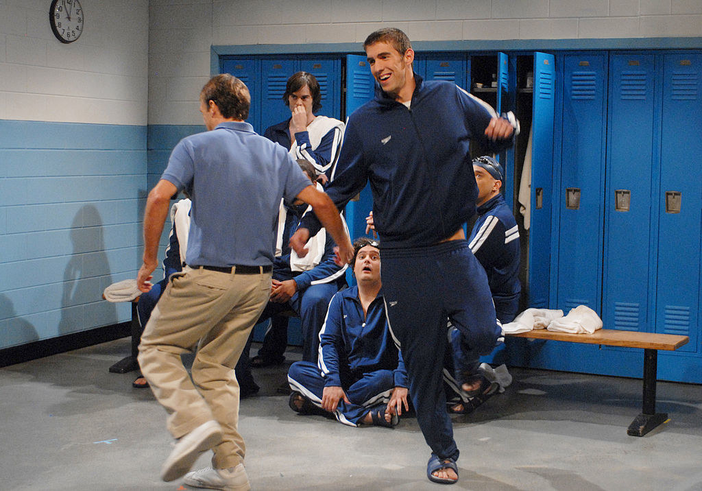 Michael Phelps skipping in a locker room during a sketch