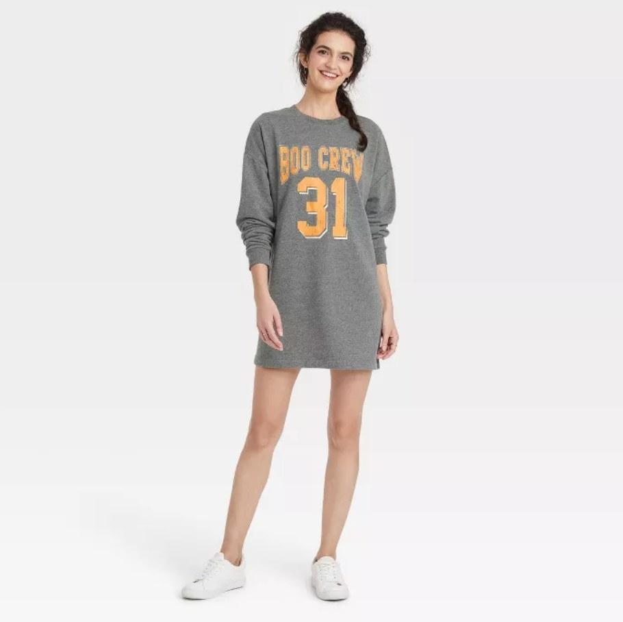 a model wearing the dress in grey