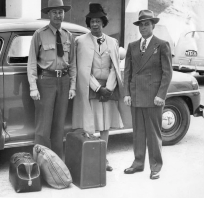 Lucy standing in between two men