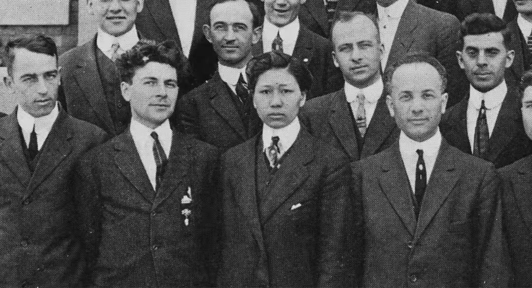 Chung during medical school, surrounded by white men