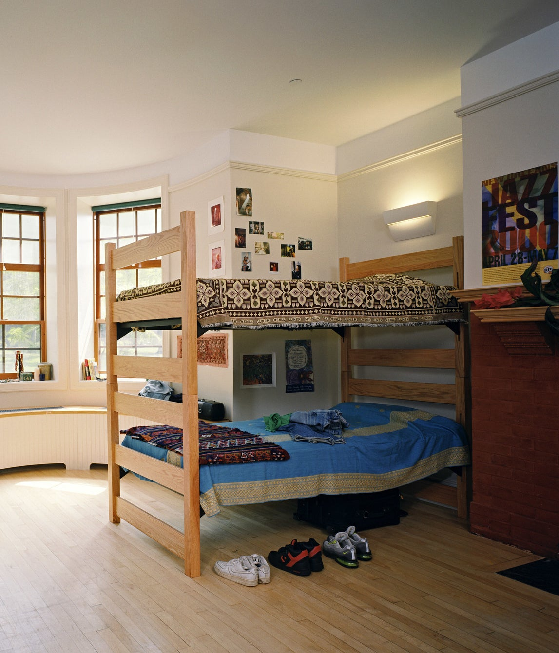 A bunk bed with clothes strewn on top