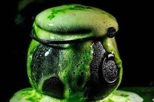plastic cauldron with fizzing bath bomb inside