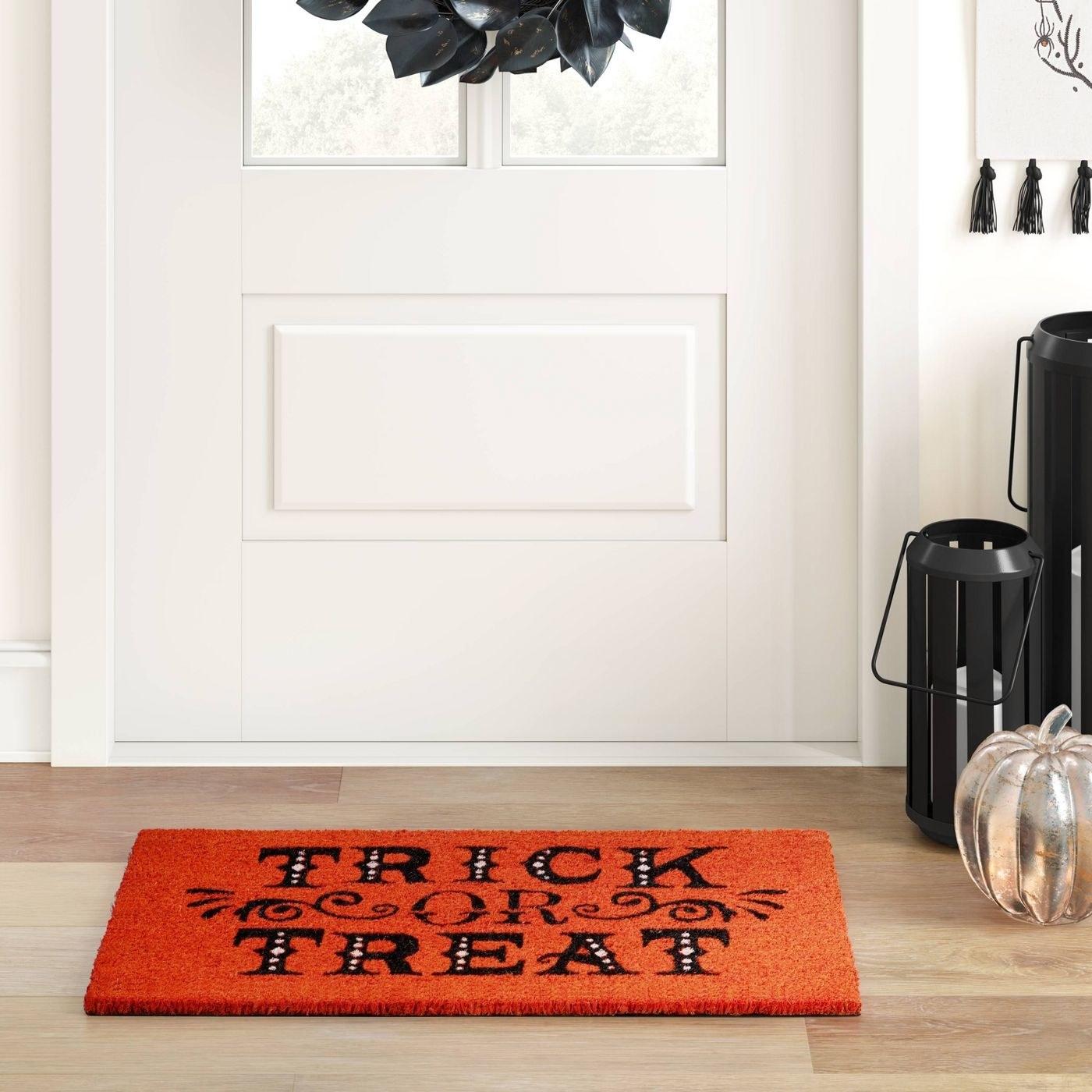 A trick or treat doormat