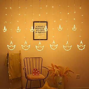 Diya lights against a chair