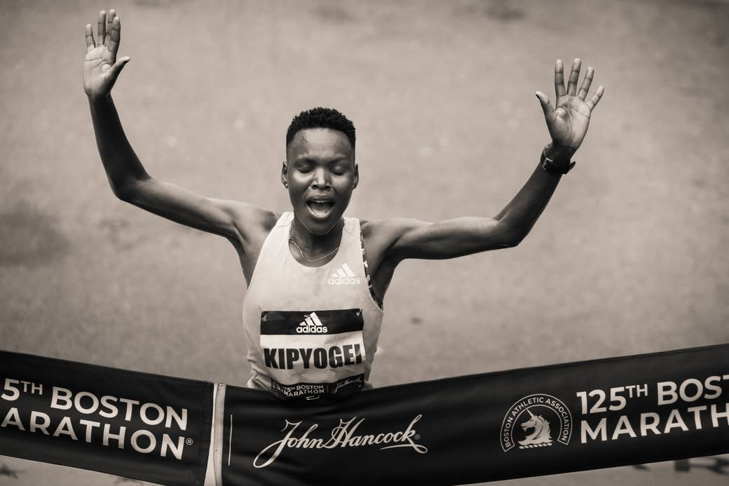 Kipyogei crosses the finish line of the Boston Marathon
